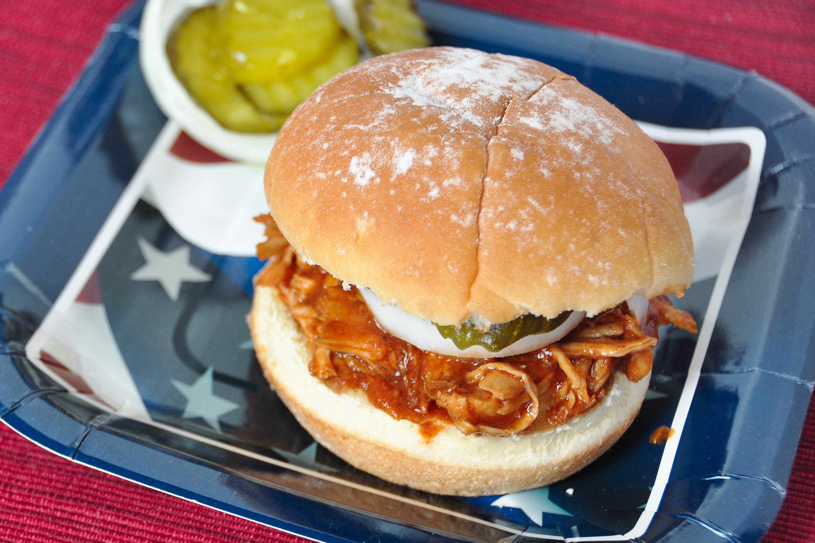 Slow Cooker BBQ Chicken- super simple and delicious. Use for sandwiches, tacos and more! | www.nutritiouseats.com