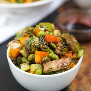 Roasted Edamame, Squash and Brussels Sprouts with Pomegranate Molasses- the perfect veggie side to bring to the Holiday table | Nutritious Eats
