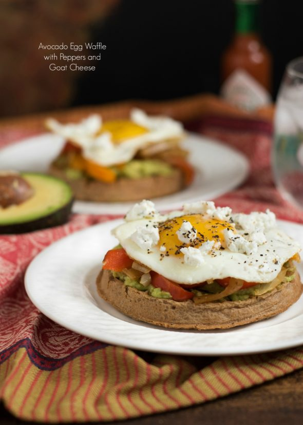 Avocado Egg Waffle with Peppers and Goat Cheese- who says waffles need syrup? These whole grain waffles plus avocado, veggies and egg make a filling and savory breakfast or brunch | www.nutritiouseats.com