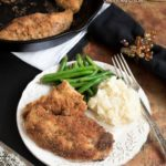 Parmesan and Pecan Crusted Oven Baked Chicken- a lightened up version of some good ol' comfort food | www.nutritiouseats.com
