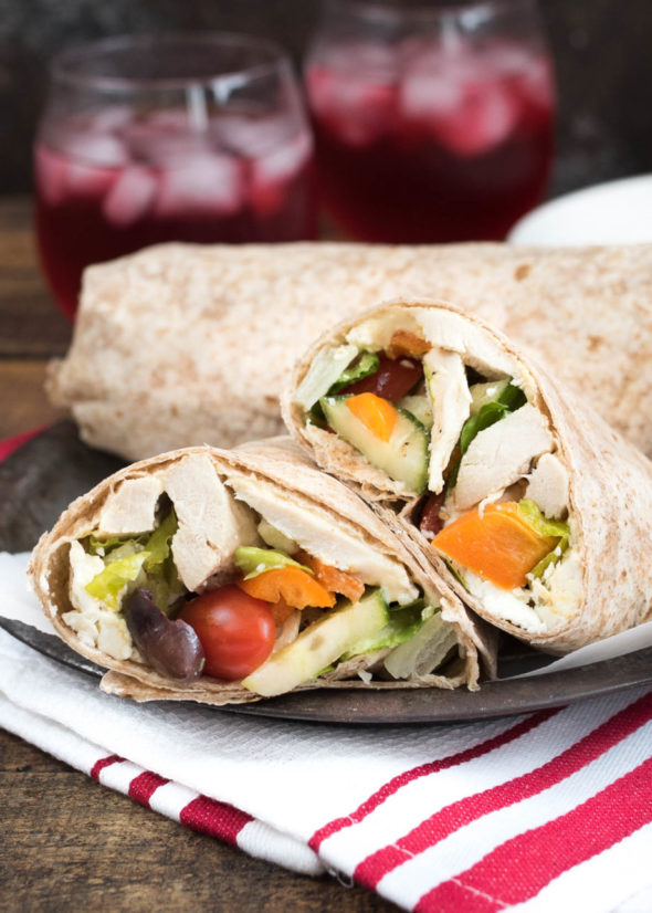 Mediterranean Chicken Wrap- Greek Salad, hummus and seasoned chicken make up this tasty wrap. Great for leftovers or a make-ahead meal! | www.nutritiouseats.com