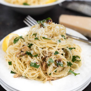 Lemon and Walnut Angel Hair Pasta- ready in less than 15 minutes + vegetarian. A simple weeknight side! | www.nutritiouseats.com