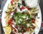 Loaded Mediterranean Fries- Truffle Fries loaded with veggies and Mediterranean flavors like feta, oregano and tzatziki sauce #glutenfree #vegetarian | www.nutritiouseats.com