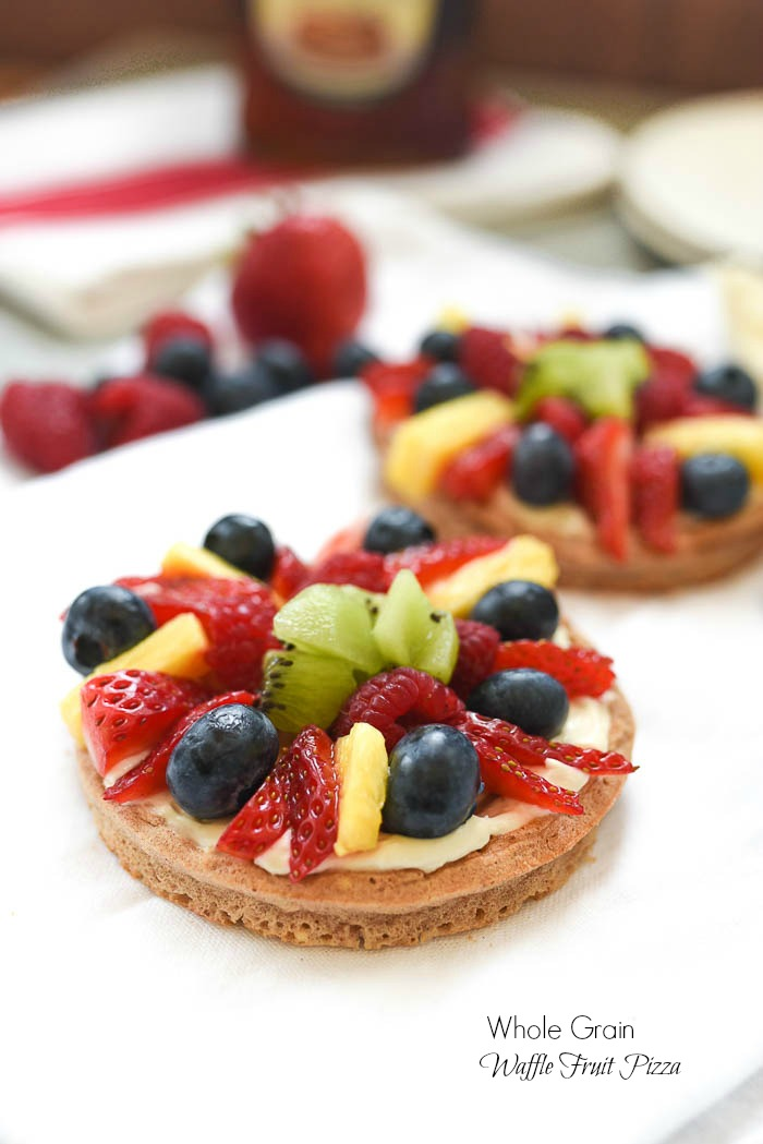 Whole Grain Waffle Fruit Pizza- this simple and fun balanced breakfast is great way to jazz up your waffles. Topped with whipped vanilla cream cheese and all the fruit! #glutenfree | www.nutritiouseats.com