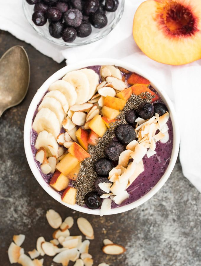 Blueberry Smoothie Breakfast Bowl- a delicious and nourishing bowl that is gluten free, plant based and great for any meal! #ad   www.nutritiouseats.com