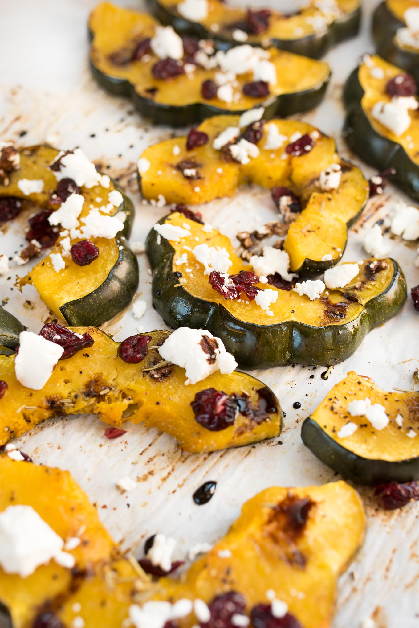 Roasted Acorn Squash with Cranberries, Goat Cheese and Balsamic Glaze #glutenfree #vegetarian side that will be perfect on your Holiday table | www.nutritiouseats.com