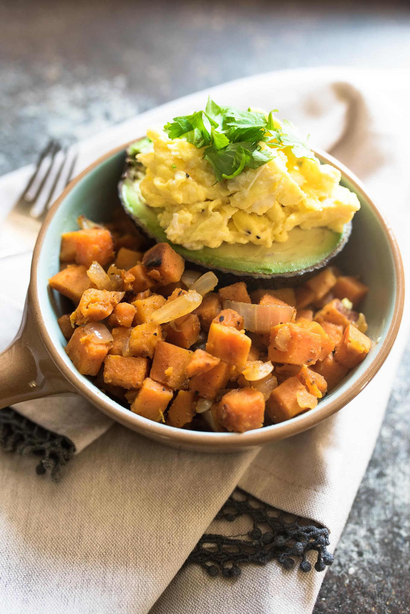 Spiced Sweet Potato Hash with Avocado and Eggs is naturally gluten free, high in fiber and protein and is a budget friendly meal that will nourish you inside and out!