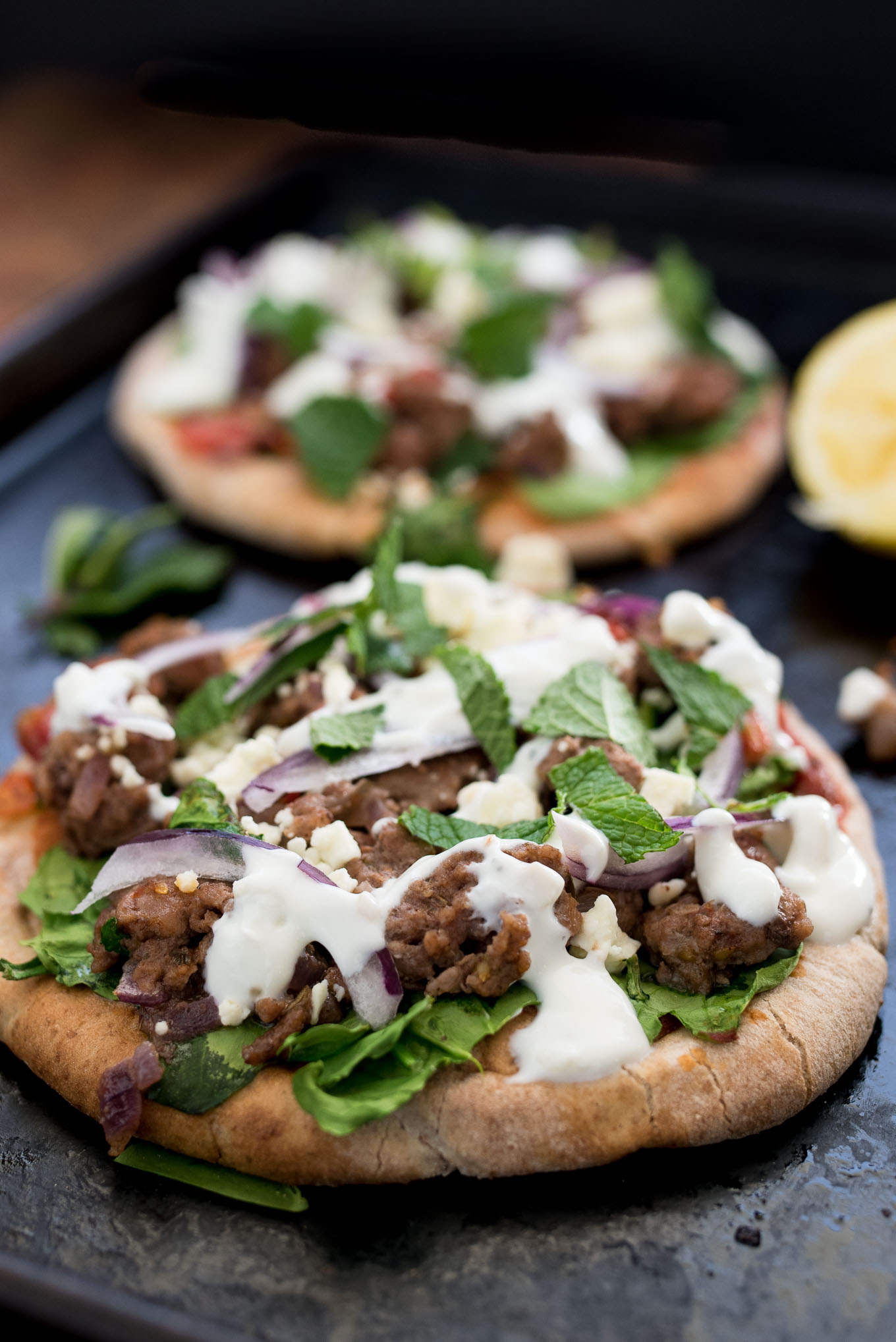 Lamb and Spinach Pita Pizza uses convenient pita bread for the crust and is flavor packed dish ready in under 30 minutes.