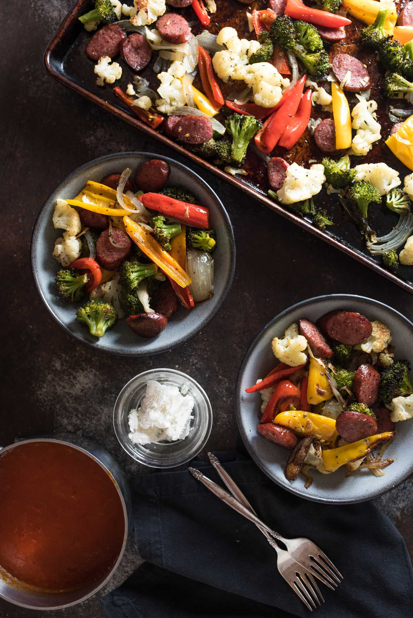 One Pan Roasted Sausage and Vegetables with Marinara and Goat Cheese is low calorie, gluten free and the answer to your dinner dilemma since it only takes a few minutes to prepare and the frees up time while it bakes in the oven.