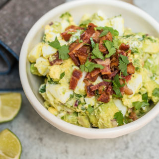 Guacamole Egg Salad tastes like that perfect guacamole recipe only a little heartier with the addition of eggs and bacon. It makes a great dip, sandwich or salad topping.