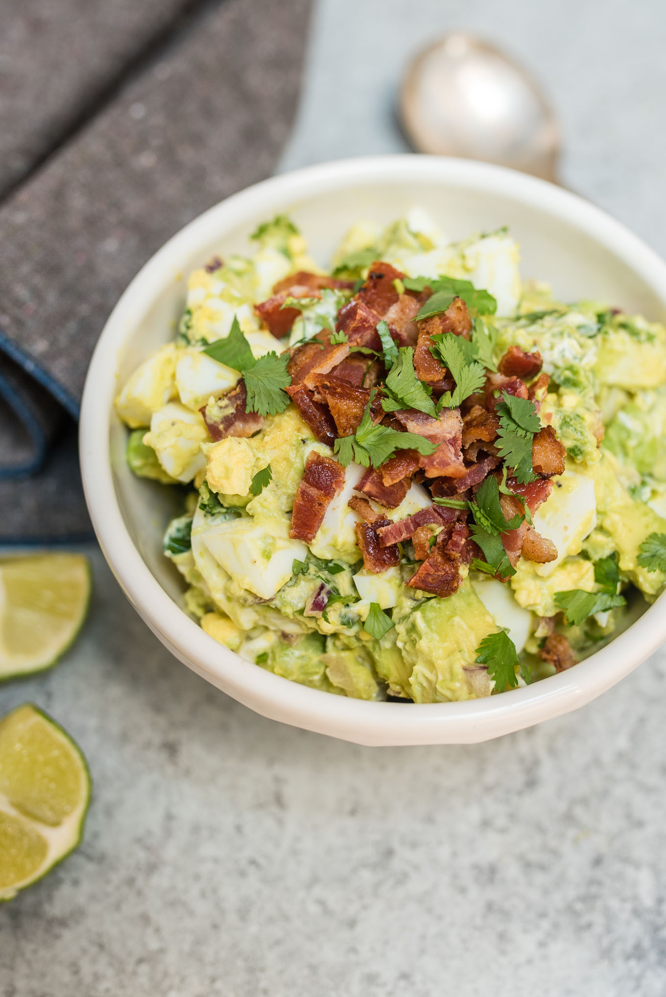 Guacamole Egg Salad tastes like that perfect guacamole recipe, but a little heartier with the addition of eggs and bacon. It makes a great dip, sandwich or salad topping.