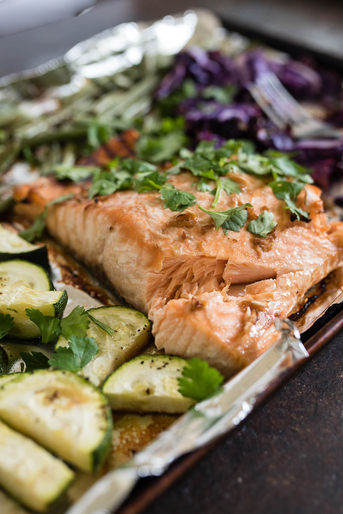 One Sheet Pan Asian Salmon and Veggies is for the healthy conscious salmon lover that wants an easy, tasty and healthy meal.