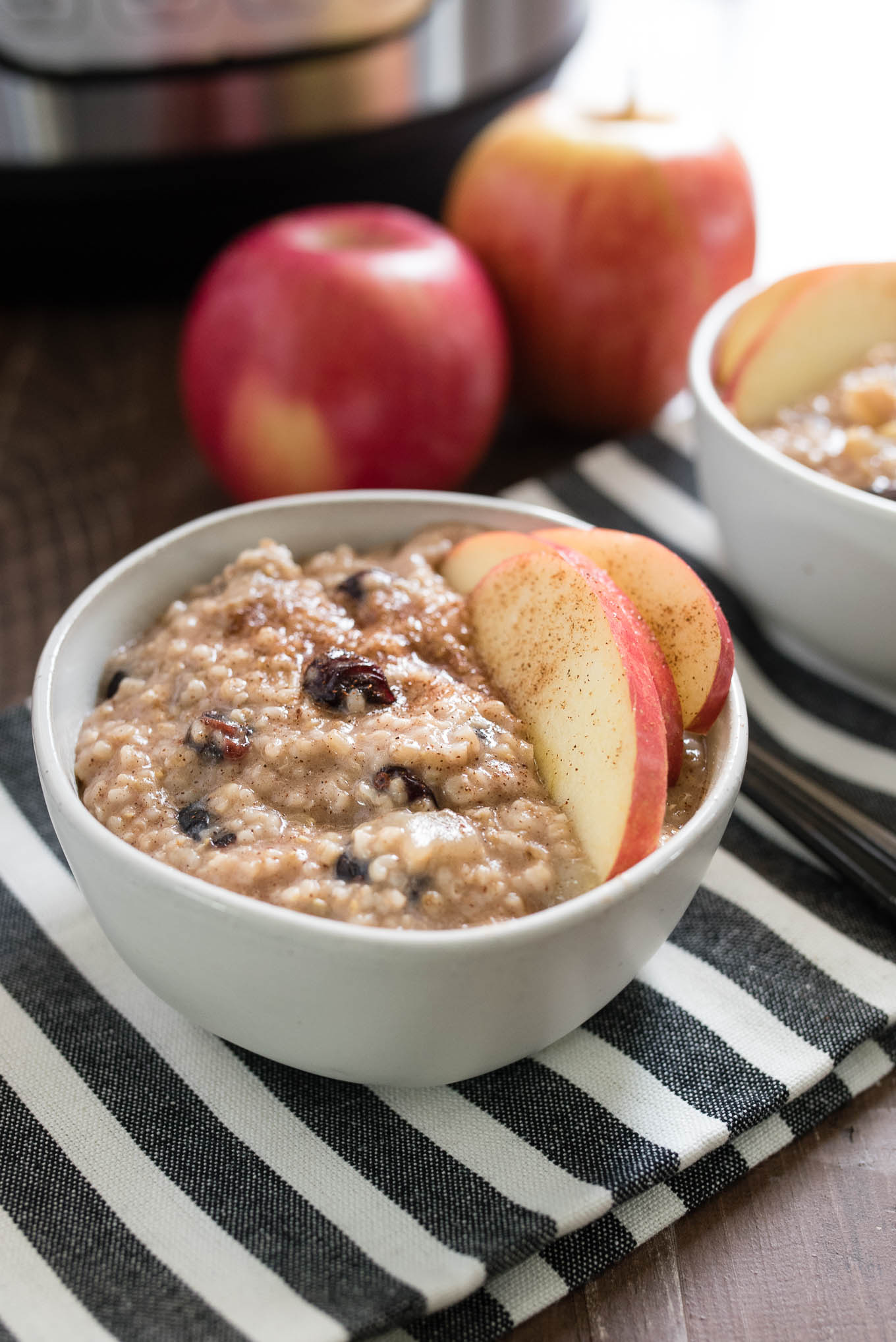 Instant Pot Apple Cranberry Steel Cut Oats are extra creamy and flavorful and you don't have to babysit the stovetop!