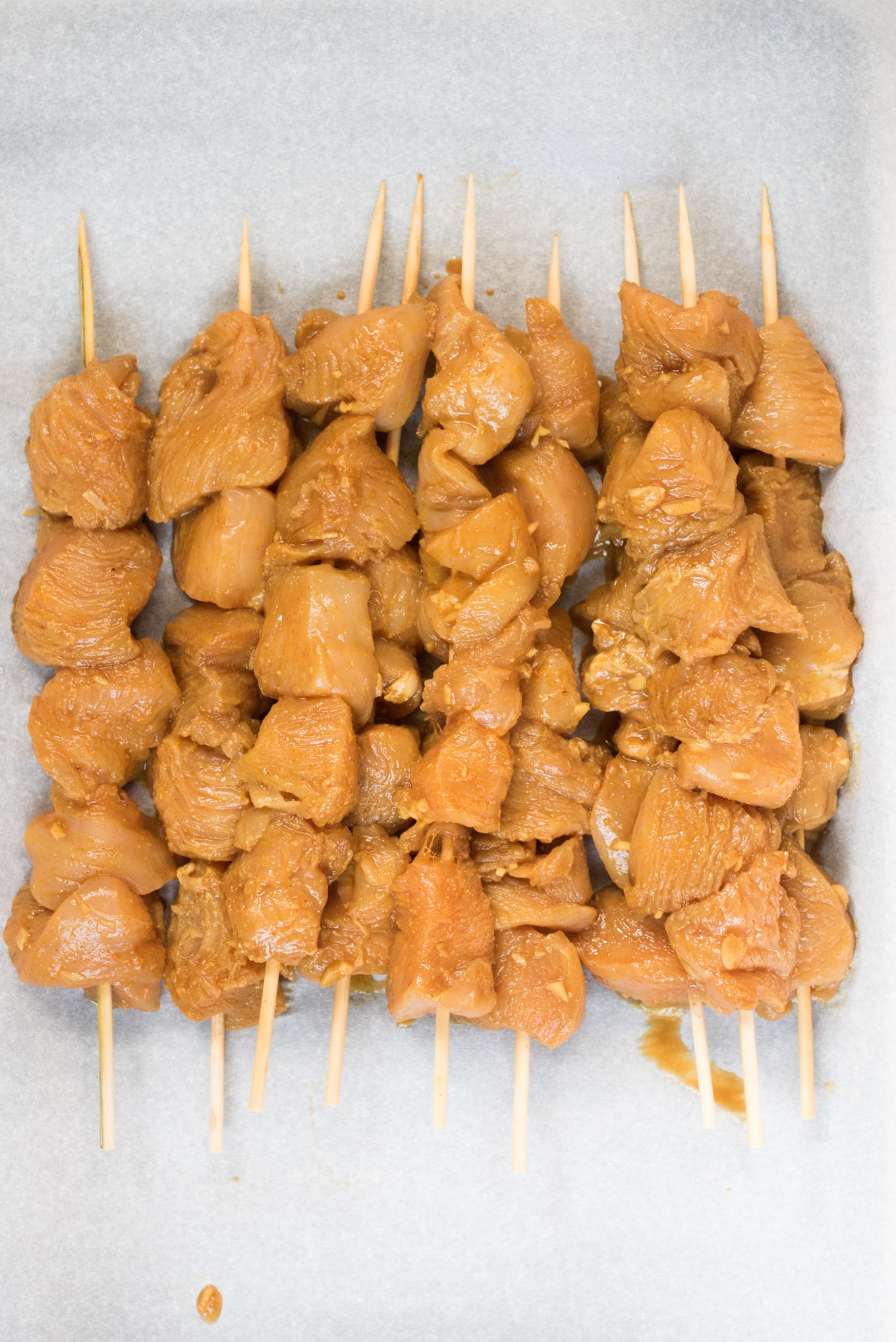 Marinated raw chicken skewers