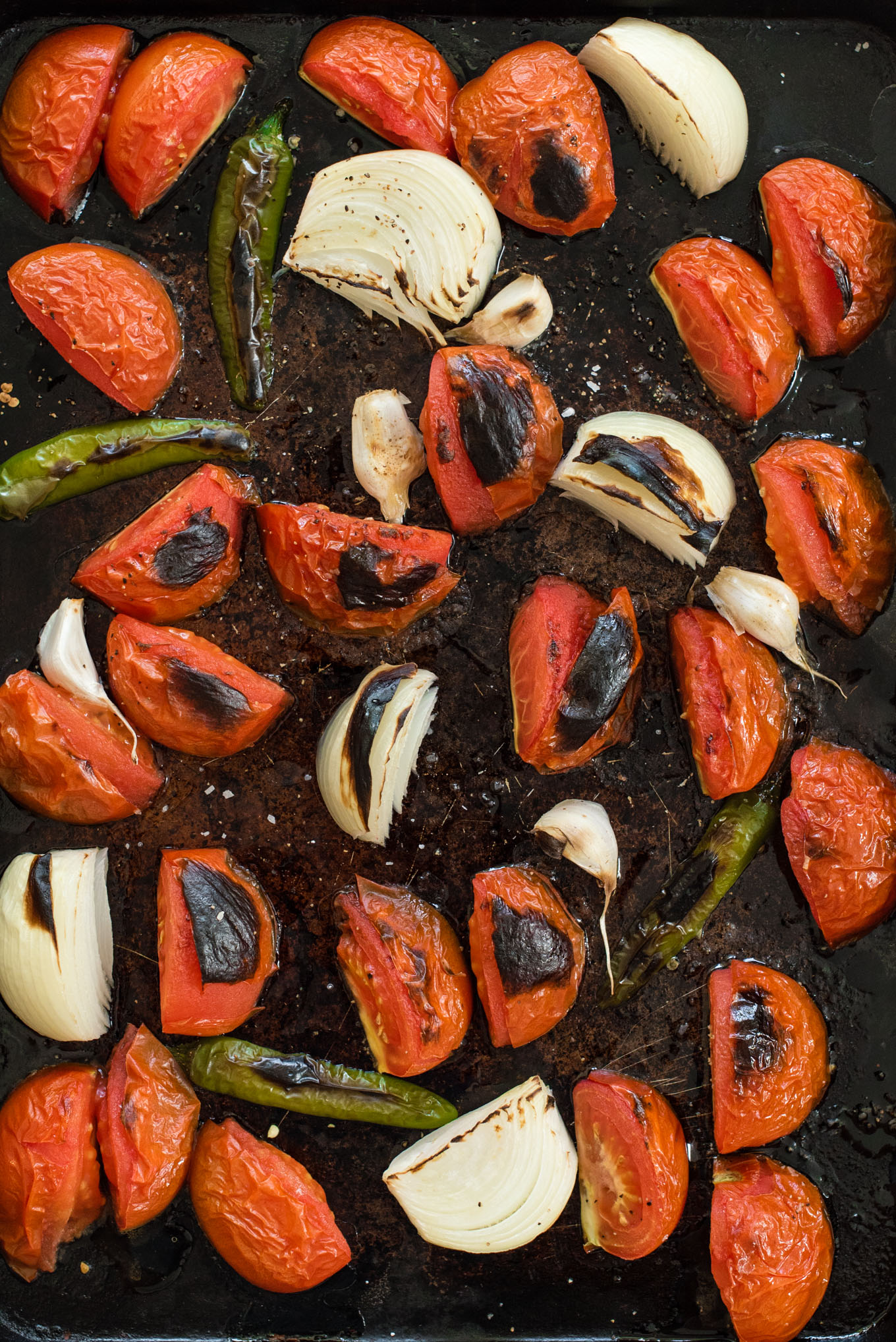 Sheet pan with roasted tomatoes, onions, peppers